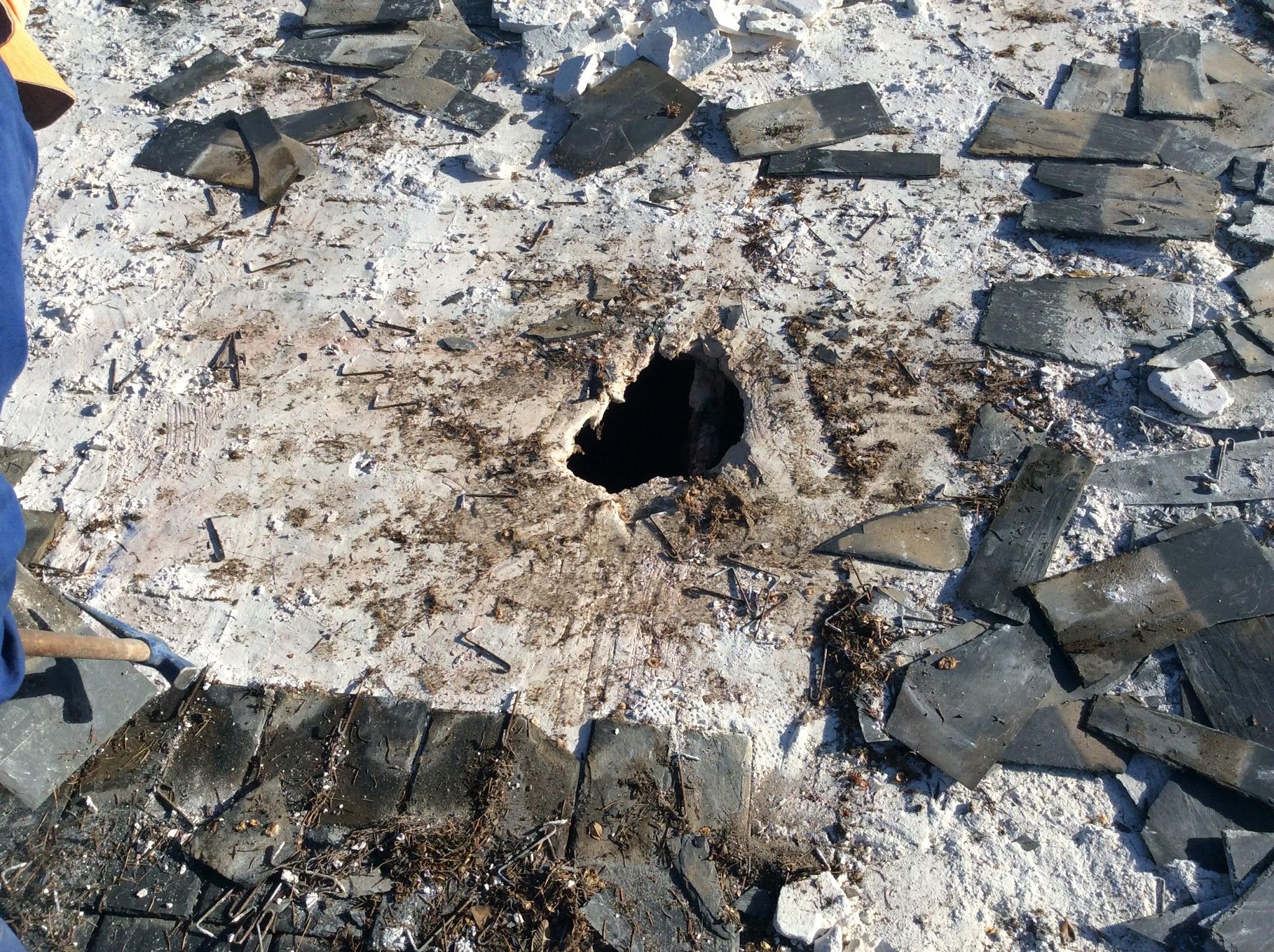 Precio de reparar base en tejados de pizara