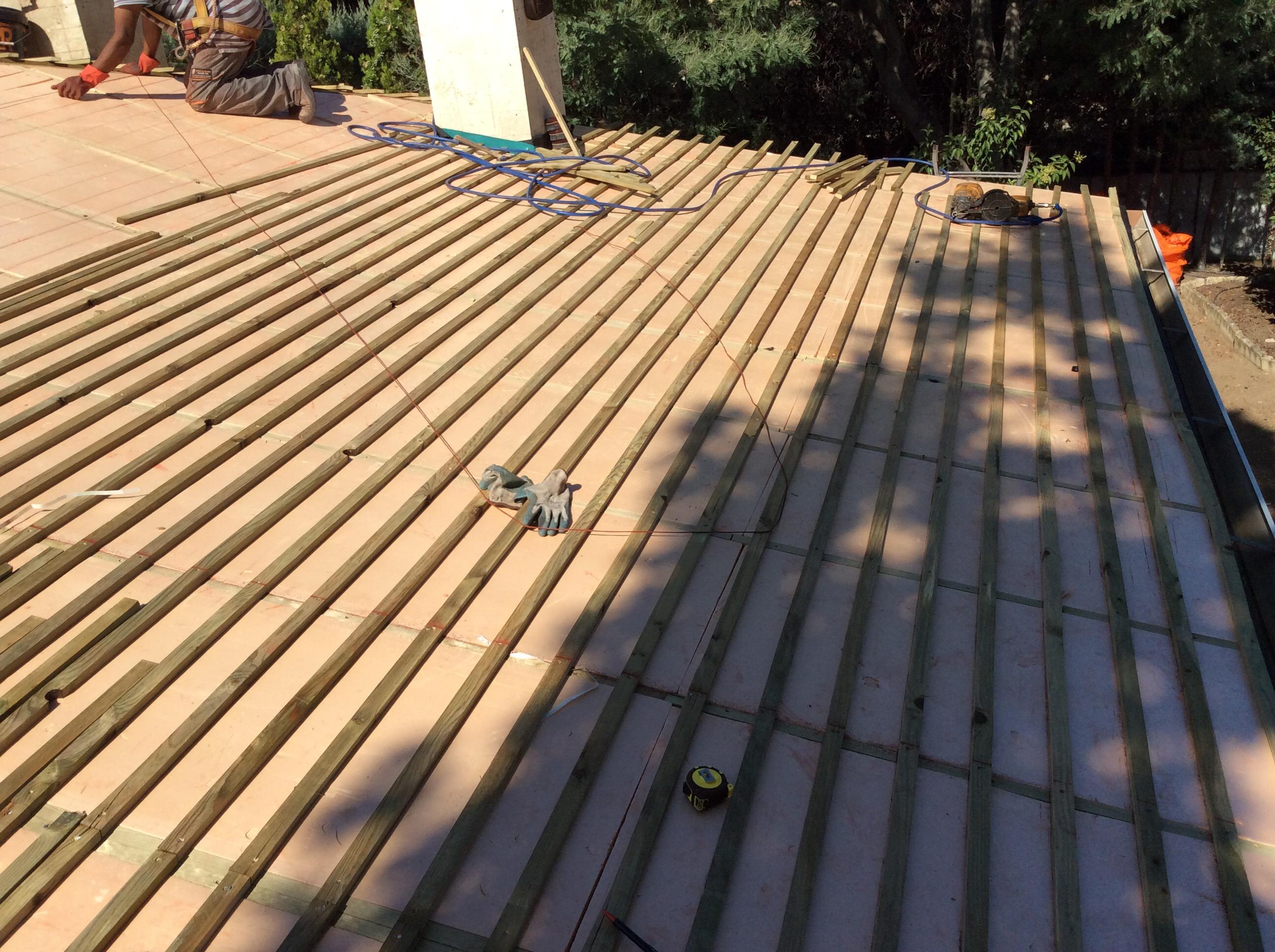 colocación de pizarra en tejados con aislamiento termico
